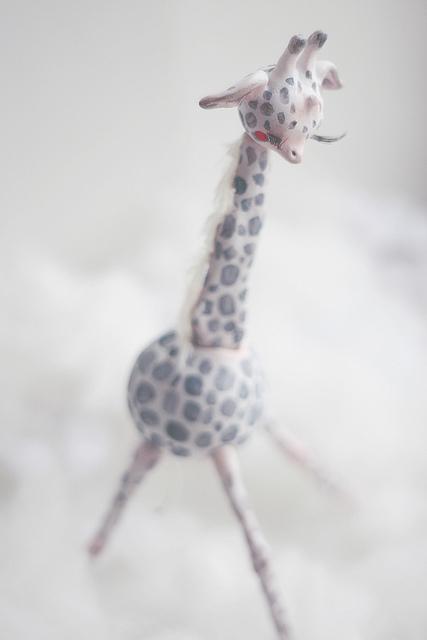 He walks through the rain clouds by oso polar sculpture