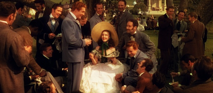 Scarlett with all of her obsequious beaus in gone with the wind