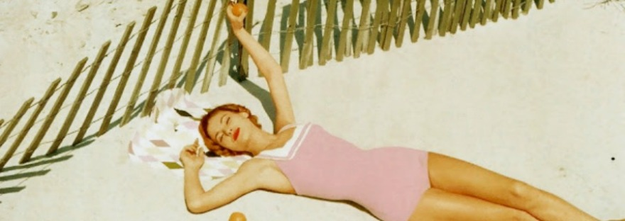 apricating bathing beauty via a Vogue beach photo shoot 1940s-60s via LaWhimsy